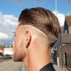 Mid Bald Fade with Textured Brushed Back Hair
