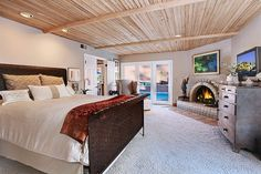 main bedroom with a view of the backyard and beach