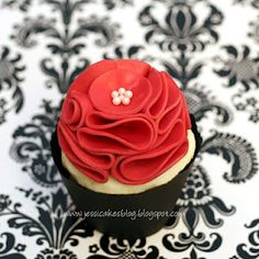 Ruffle Cupcake from Jessica's Cakes.  This site has lots of tutorials.