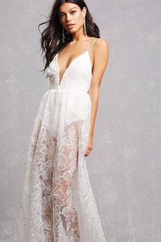 This stunning dress features an embroidered sheer organza fabric, dual cami straps that crisscross in back, a knit bodysuit underlay with a snap-button closure, and a concealed back zipper.<p>- This is an independent brand and not a Forever 21 branded item.</p>