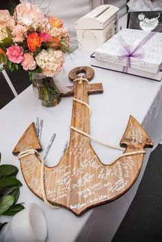 Wooden anchor decor for a unique wedding book for guest signatures.