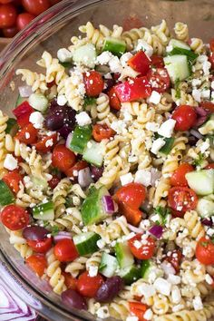 This easy Greek Pasta Salad with feta is quick to make and delicious to eat! Serve it as a side with chicken or on its own for a perfect lunch on the go!