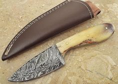 "Christmas Gift Offer by ColdLand Knives | 7.5"" Custom Handmade Damascus Steel Hunting Skinner Knife SH01-B. WARNING: Please buy from Leather-n-Dagger ONLY when you see (""Sold by Leather-n-Dagger and Fulfilled by Amazon""). Other sellers are selling FAKE COPIES of our products with CHEAP QUALITY. Our branded products are: ""Leather-n-Dagger"", ""ColdLand Knives"" and ""Rocky Knives"". Thanks a million !!!. Solidly built for tough use such as hunting, camping, other outdoor sports, bush craft..."