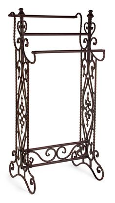 "Traditional, narrow wrought iron quilt or towel rack in a dark finish with open-metalwork design features 3 horizontal bars Product Description • Product Dimensions: 36"" H x 16.25"" W x 13.25"" • Produc"