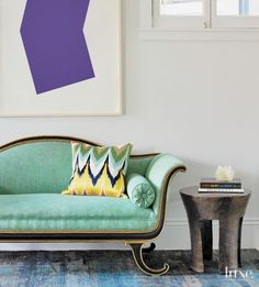In the entry, a simply framed lithograph by Ellsworth Kelly juxtaposes with an English Regency settee.