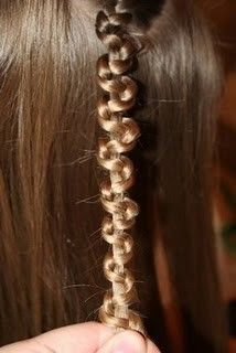 make a regular braid at the end hold one of the sections of hair and with your other hand push the other two sections up.