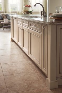 Green kitchen cabinets beautiful kraftmaid cabinets for Brushed sage kitchen cabinets