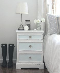 Refurbish a nightstand with paint or wallpaper on front of drawers