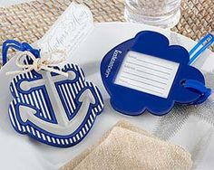 """◾Nautical-themed, rubber, navy-and-white ship's anchor luggage tag with rope bow ◾Clear window on back with insert for contact information  ◾Luggage tag measures 4 1/2"""" h x 3"""" w ◾Package tag only"""