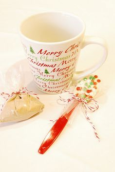 Cool holiday gift...Mugs with hot chocolate and chocolate dipped spoons