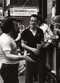 Joe Strummer and Martin Scorsese on the street.  I wish I could jump in there, push the blonde down, and be a part of one of the coolest pictures ever.