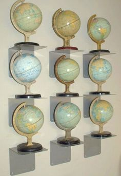 GLOBE~ display idea. These are mostly biscuit (cookie) tins, they opened. They are WONDERFUL!