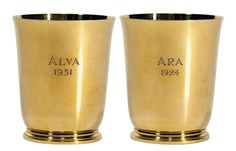 """Set of 12 Gold Cordial Cups. 18 kt. gold, each outscrolled rim above a circular body, raised on a conforming molded base, inscribed Ara 1924 and Alva 1931, marked Tiffany & Co Makers #18992, approximately 771 dwt. Height 2 1/2 inches, diameter 2 1/8 inches. Estimate $40,000 - $60,000. Made for a gold rectangular tray. """"Ara"""" was the name of Mr. W K Vanderbilt Jr.'s first yacht on which he made a trip halfway around the world in 1927."""