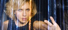 Scarlett Johansson's Lucy sorting through grid of data
