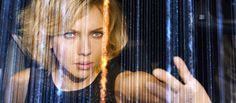 Scarlett Johansson's Lucy sorting through grid of data