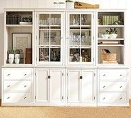 Loooove all the storage room and glass front cabinet doors.