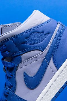 """In a classic two-tone color block, the Women's Air Jordan 1 Mid """"Iron Purple"""" channels the look of the silhouette's original colorways from back in the day, but with a modern flair. Jordan 3, Air Jordans, Iron, Silhouette, Purple, Classic, Sneakers, Modern, Color"""