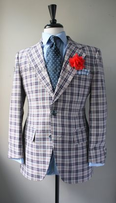 new in stock: navy blue and cranberry plaid blazer with polka dot tie and a flower lapel pin