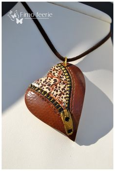 """From Fimo Feerie - tutorial for the zippered heart. Click, link in first line which reads, """" tuto coeur de cuir"""" Polymer Clay Pendant, Fimo Clay, Polymer Clay Projects, Polymer Clay Creations, Polymer Clay Crafts, Polymer Clay Jewelry, Zipper Jewelry, Leather Jewelry, Clay Design"""