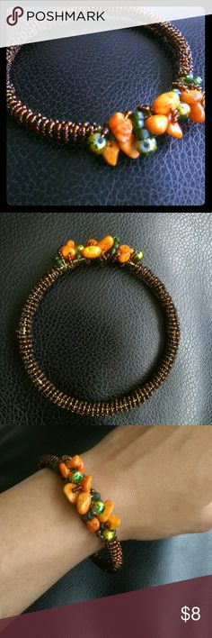 """Tahiti Sunset Bangle 2.5"""" diameter bangle.  Hand wired, beaded and coiled.  Accented with colored and translucent stones and marble beads. BSC & Co   Jewelry Bracelets"""