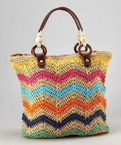 Before heading off to the beach, don& forget this wonderfully woven tote! Spacious enough to fit a favorite book and a towel for lounging, this braided bag shows off functional style with a vibrant zig-zag pattern that is sure to impress. Chevron Crochet, Crochet Tote, Crochet Handbags, Crochet Purses, Crochet Pattern, Free Crochet, Handmade Handbags, Handmade Bags, Lidia Crochet Tricot