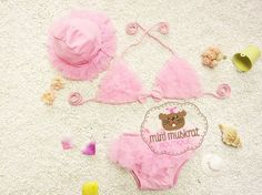 This adorable chiffon bikini is SO precious! It comes with the sun hat, too.  This is a pre order item.