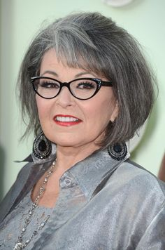 This bob hairstyle on Roseanne Barr (born November 3, 1952) is flattering to her round face shape. Note the sweeping bangs and the wonderful gray colors throughout her hair.