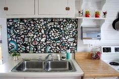 Mosaic back splash with black grout by lorraine
