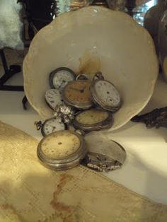 Old watches in vintage ironstone bowl