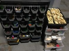 TWO FILING BOXES FILLED WITH LEGO PARTS - BLOCKS, PEOPLE AND OTHER MISCELLANEOUS PIECES.