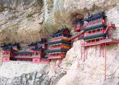 The Hanging Temple Monastery of Hengshan literally hangs on the side of Hengshan Mountain, China sustained by only a few wooden poles.    Built in 491, Hanging Monastery is an architectural wonder because it hangs on the west cliff of Jinxia Gorge more than 50 meters above the ground.