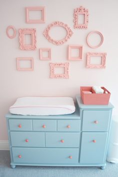 this could be a good way to add pink that can be painted over if girl ends up being boy. oh and I would put pictures in the frames though. . Such a cute vintage room