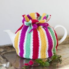 Striped Tea Cosy Crochet Pattern by Mon Petit Four. This is my favourite tea cozy, ever! I'm pretty sure that the bottom could be finished with a simple row of single crochet stitches, though. Crochet Tea Cosy Free Pattern, Tea Cosy Pattern, Crochet Cozy, Crochet Gifts, Free Crochet, Crochet Patterns, Top Pattern, Crochet Geek, Corset Pattern