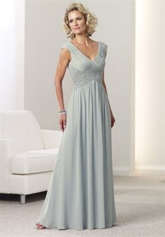 Mother-of-the-Bride/Groom Dress features beading, inverted basque waist, and matching shawl.