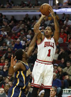 39732fd29acd Chicago Bulls guard Derrick Rose shoots over Indiana Pacers forward Solomon  Hill during the second half of an NBA basketball game in Chicago
