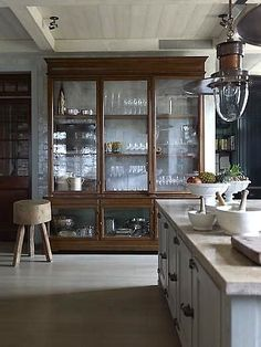 Massive vintage cabinet as a kitchen focal point.   Via www.srgambrel.com