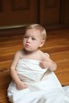my daughter Elle in my wedding dress. (1 year old)