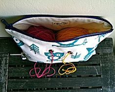 Yarn Pop Bag: Turquoise Owls project bag from Lion Brand Yarns.  I love the idea of using grommets to run your yarn through.