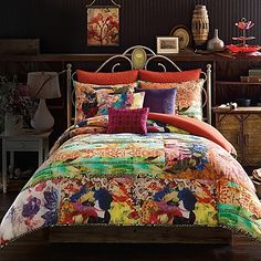 The Tracy Porter Poetic Wanderlust Willow Reversible Comforter Set beautifully exhibits her style with its rich color palette and eclectic prints that form a modern collage. This inspired comforter set includes a reversible comforter and pillow shams.
