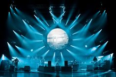 I love this lighting at a Pink Floyd concert because it gives me the same psychedelic feeling their music gives me. I feel like the lighting should be able to represent the artist and the vibe they are trying to create with their music and these blue lights really do a good job at that.