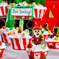 Our fave ideas for a Christmas treats table: DIY a *Bah Yumbug* sign with a green candy stick and printable thank-you card. Click for all the cupcake decorating awesomeness!