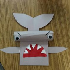 Hammerhead shark...made with paper towel roll for 3D effect. Mouth is half a small paper plate.
