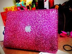 pink glitter mac book..makes me want to bedazzle my mac book air!