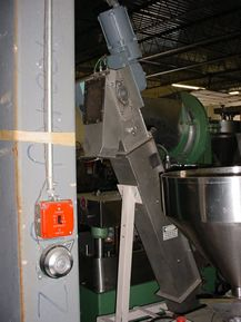 """1-USED STAINLESS STEEL BUCKET ELEVATOR. WITH STAINLESS STEEL PERFORATED BUCKETS, EACH MEASURING APPROX. 5"""" X 2"""". DRIVEN BY 1/3HP EXPLOSION PROOF MOTOR. MOUNTED ON APPROX. 36"""" HIGH STAND, WHICH PROVIDES FOR ELEVATOR PRODUCT DISCHARGE HEIGHT OF 72"""". LAST CONVEYING COFFEE BEANS."""
