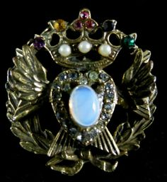 Regal Vintage Goldtone Rhinestone and Moonstone Heraldic Brooch Signed Coro | eBay