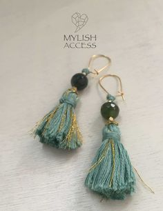 green and jade-blue with gold accents <3