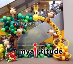 Giraffe and monkeys arch by Lily Tan
