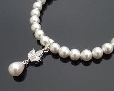 This is a stunning bracelet, handmade with a single row of pearls with a petal shaped Swarovski crystal drop, teardrop freshwater pearl to the front. Rustic Wedding Jewelry, Bridal Jewelry, Pearl Choker, Pearl Bracelet, Spring Wedding Inspiration, Wedding Ideas, Flower Fashion, Fashion Bracelets, Wedding Accessories