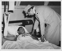 Eleanor Roosevelt Talks with a Wounded Soldier, 08/1943 - 09/1943
