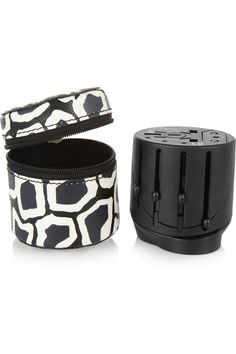 Diane von Furstenberg | Faux textured-leather case and travel adapter | This is the PERFECT travel adapter. No more clunky boxes with thousands of attachements!